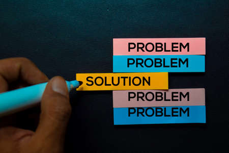 Problem or Solution text on sticky notes isolated on Black desk. Mechanism Strategy Concept