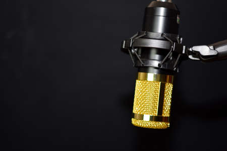 Close-up of retro microphone isolated on bokeh black background Stok Fotoğraf
