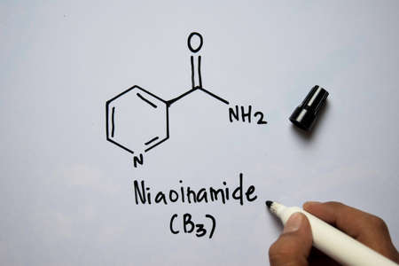 Niaoinamide (B3) molecule written on the white board. Structural chemical formula. Education concept Imagens