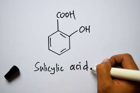 Salicylic Acid molecule written on the white board. Structural chemical formula. Education concept