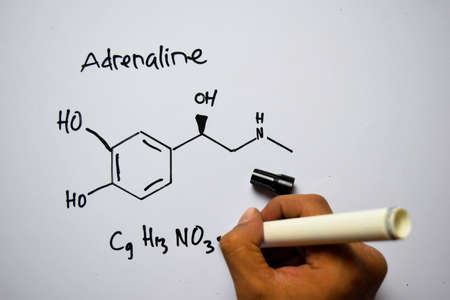 Adrenaline (C9,H13,NO3) molecule written on the white board. Structural chemical formula. Education concept