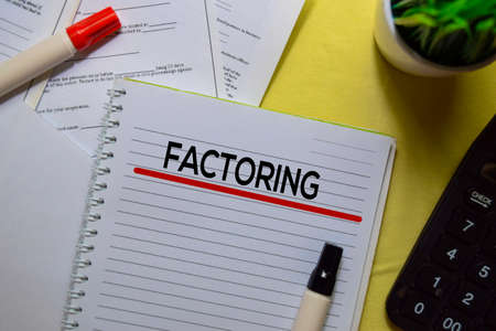 Factoring text on a book isolated on office desk.