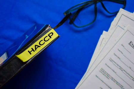 HACCP text on sticky notes isolated on office desk.