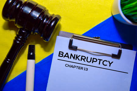 Bankcrupty Chapter 13 text on Document form and Gavel isolated on office desk.