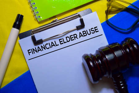 Financial Elder Abuse text on Document form and Gavel isolated on office desk.