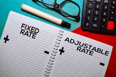 Fixed Rate and Adjustable Rate text on a book isolated on office desk.