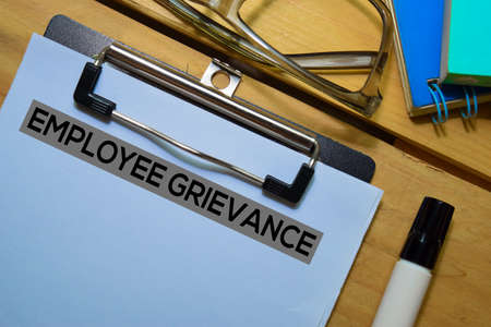 Employee Grievance text on Document form isolated on office desk. Stok Fotoğraf