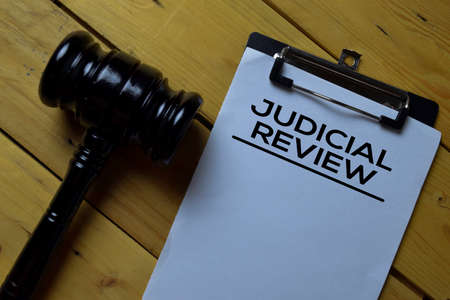 Judicial Review Document form and Black Judges gavel on wooden desk. Law concept Stockfoto