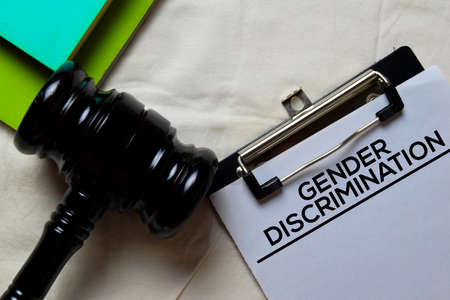 Gender Discrimination Document form and Black Judges gavel on office desk. Law concept Stock Photo