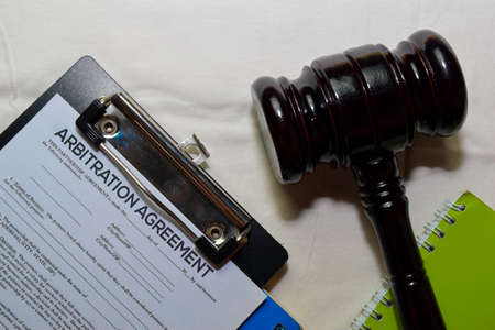 Arbitration Agreement Document form and Black Judges gavel on office desk. Law concept Фото со стока
