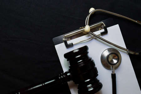 Black Judges gavel and stethoscope. Healthcare or Medical jurisprudence. Medical Law