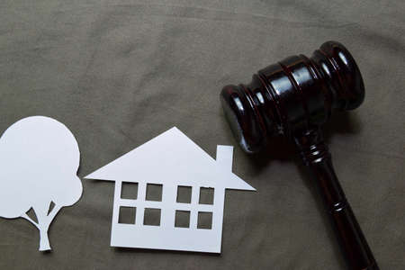 Black Judges gavel and home made form of paper on office desk. Law concept