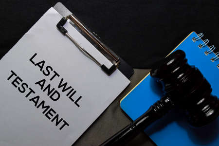 Last Will and Testament text on Document and gavel isolated on office desk. Law concept