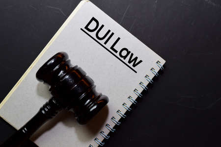 Dui Law text on Document and gavel isolated on office desk. Law concept