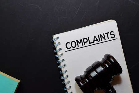 Complaints text on Document and gavel isolated on office desk. Law concept