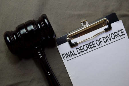 Final Decree of Divorce text on Document and gavel isolated on office desk. Law concept