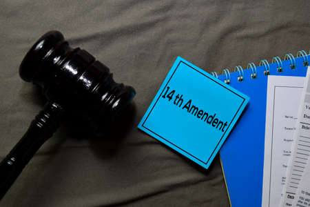 14th Amandment text on sticky notes and gavel isolated on office desk. Law concept Zdjęcie Seryjne
