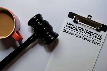 Mediation Process text on Document and gavel isolated on office desk. Law concept