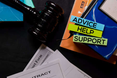 Advice, Help, Support on sticky Notes and gavel isolated on office desk. Law concept