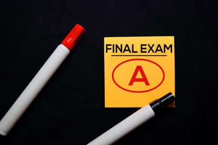 Final Exam and A in red circle on sticky notes isolated on black background