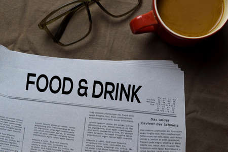 Food and Drink text in headline isolated on brown background. Newspaper concept Stok Fotoğraf