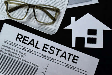 Real Estate text in headline isolated on black background. Newspaper concept Stockfoto