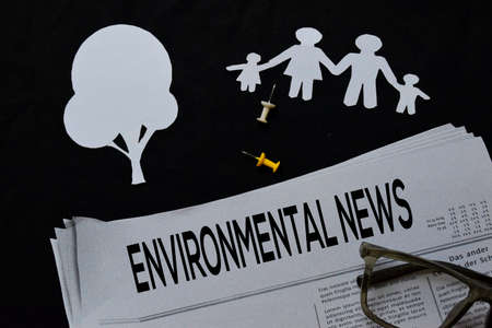 Environmental News text in headline isolated on Black background. Newspaper concept Imagens