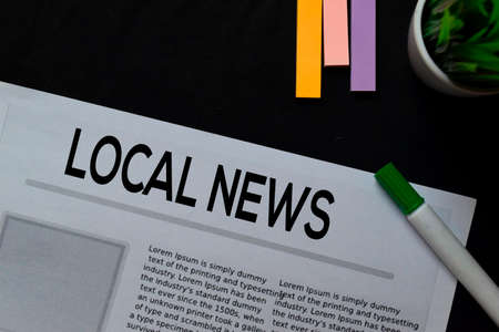 Local News text in headline isolated on Black background. Newspaper concept