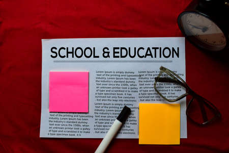 School and Education text in headline isolated on red background. Newspaper concept
