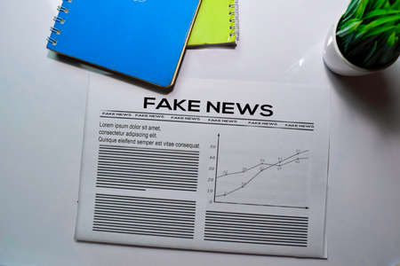 Fake News text in headline isolated on white background. Newspaper concept