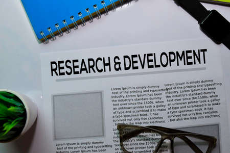 Research and Development text in headline isolated on white background. Newspaper concept