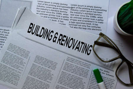 Building and Renovating text in headline isolated on white background. Newspaper concept