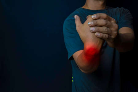 Young man suffering pain weakness and tingling in wrist. Medical or Healthcare concept