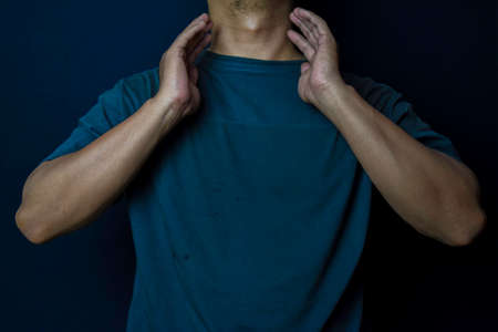 Young man thyroid gland by himself tumor or cancer on black background. Medical or Healthcare concept Stock fotó