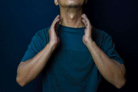 Young man thyroid gland by himself tumor or cancer on black background. Medical or Healthcare concept Stok Fotoğraf