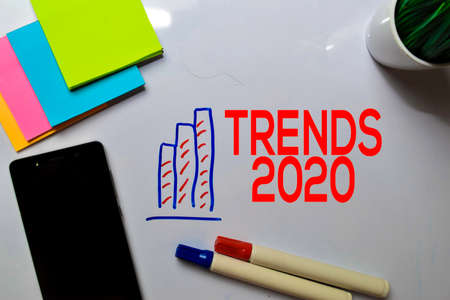 Trends 2020 Text on white board with chart,phone and sticky note.