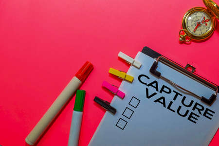 Capture Value write on Documents isolated on Pink background.