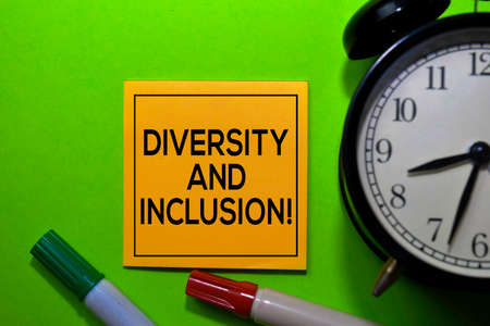 Diversity and Inclusion! write on sticky notes isolated on green background. Banco de Imagens