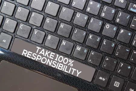 Take 100% Responsibility isolated on laptop keyboard background 免版税图像