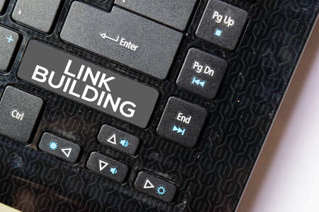 Link Building isolated on laptop keyboard background