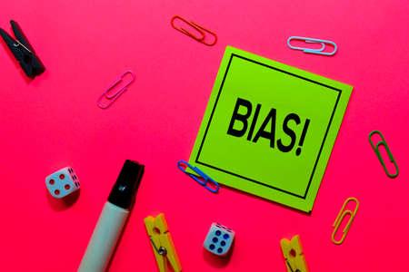 Bias! write on sticky notes isolated on Pink background. Zdjęcie Seryjne