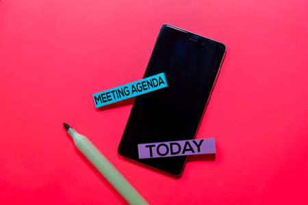 Meeting Agenda and Today write on sticky notes isolated on Pink background. Zdjęcie Seryjne