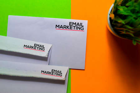 Email Marketing on post card isolated on office desk background Stockfoto