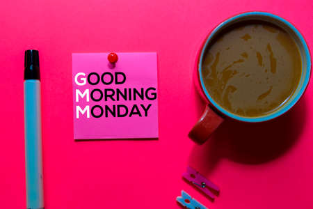 GMM. Good Morning Monday acronym on sticky notes. Office desk background