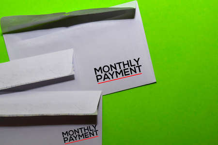 Monthly Payment on post card isolated on office desk background Stockfoto