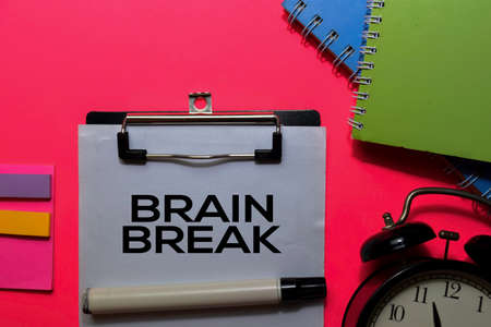 Brain Break write on paperwork. Isolated on pink table background