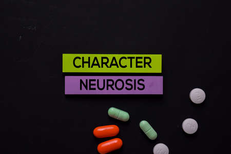 Character Neurosis text on sticky notes. Office desk background. Medical or Healthcare concept Imagens
