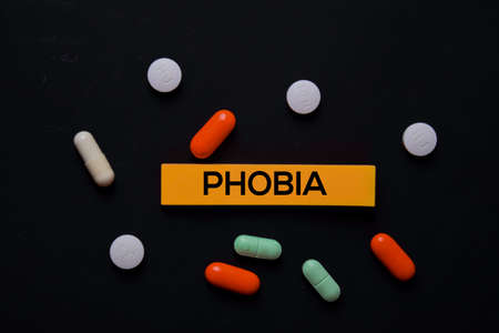 Phobia text on sticky notes. Office desk background. Medical or Healthcare concept Imagens