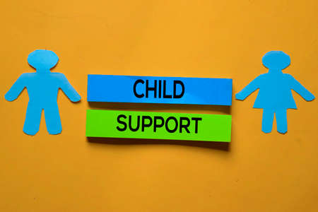 Child Support text on sticky notes. Office desk background.
