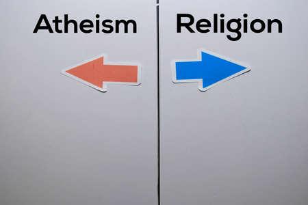 Atheism or Religion with arrow write on white board background Stok Fotoğraf